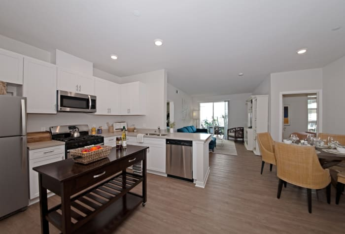 Luxurious open-concept floor plan with hardwood floors in model home at IMT Sherman Circle in Van Nuys, California