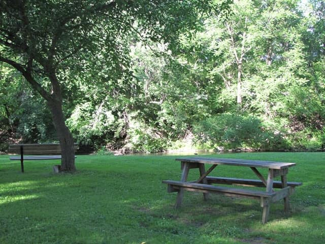 Outdoors bench at Braeside Apartments in Marcellus, NY