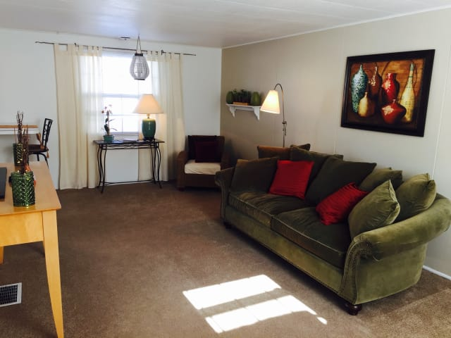 Model living room at Saddle Club Townhomes
