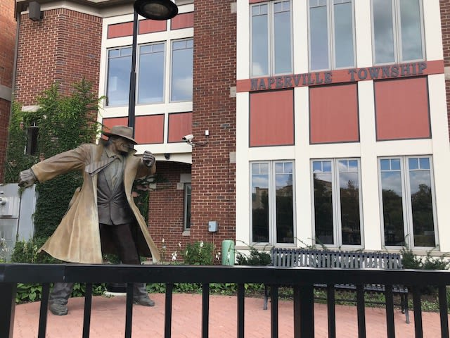 The iconic Dick Tracy statue at the Water Street District near Avenida Naperville senior living apartments in Naperville, Illinois