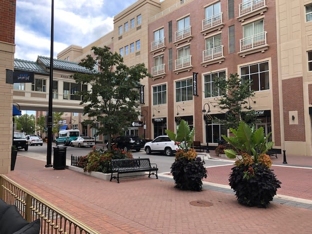 Naperville's Water Street District filled with restaurants, shops, boardwalk, parking and public art.