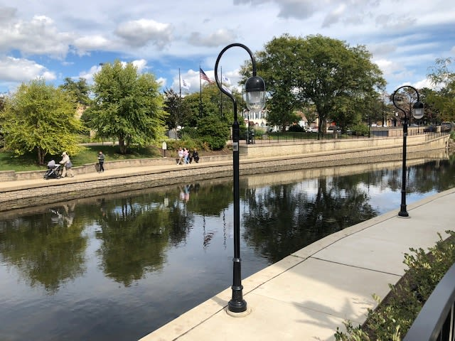 A scenic view of the DuPage River near Avenida Naperville senior living apartments in Naperville, Illinois