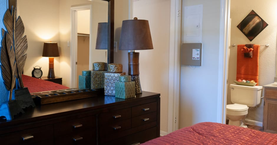 Bedroom with a dresser at Promenade at Valley Ridge in Irving, Texas