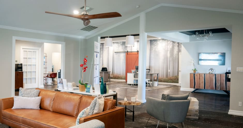 Clubhouse with a ceiling fan at Promenade at Valley Ridge in Irving, Texas