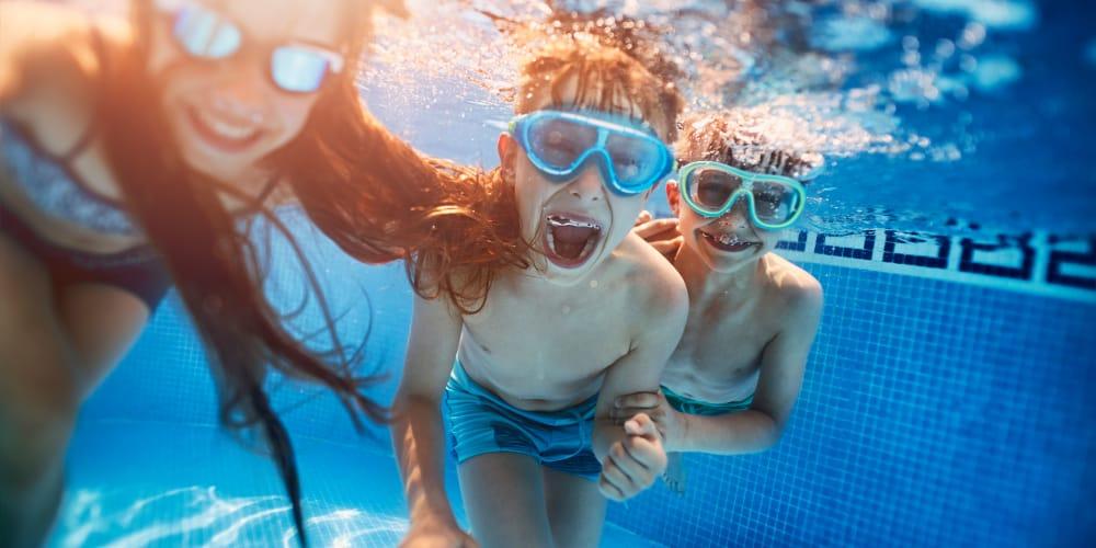 Kids swimming in the pool at Sunridge Apartments in Fair Oaks, CA