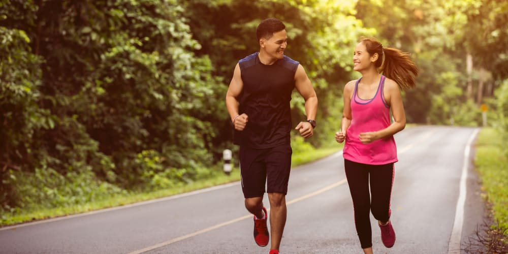 Couple jogging near Courtside Village Apartments in Woodland, CA