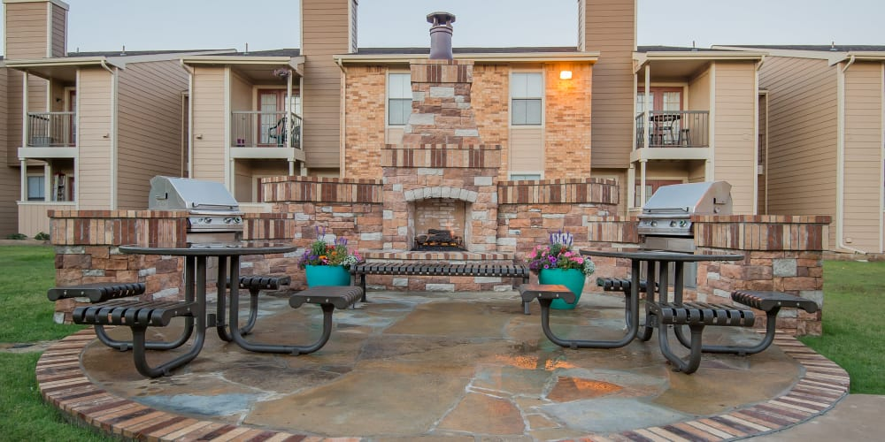 An outdoor fireplace at Cimarron Trails Apartments in Norman, OK