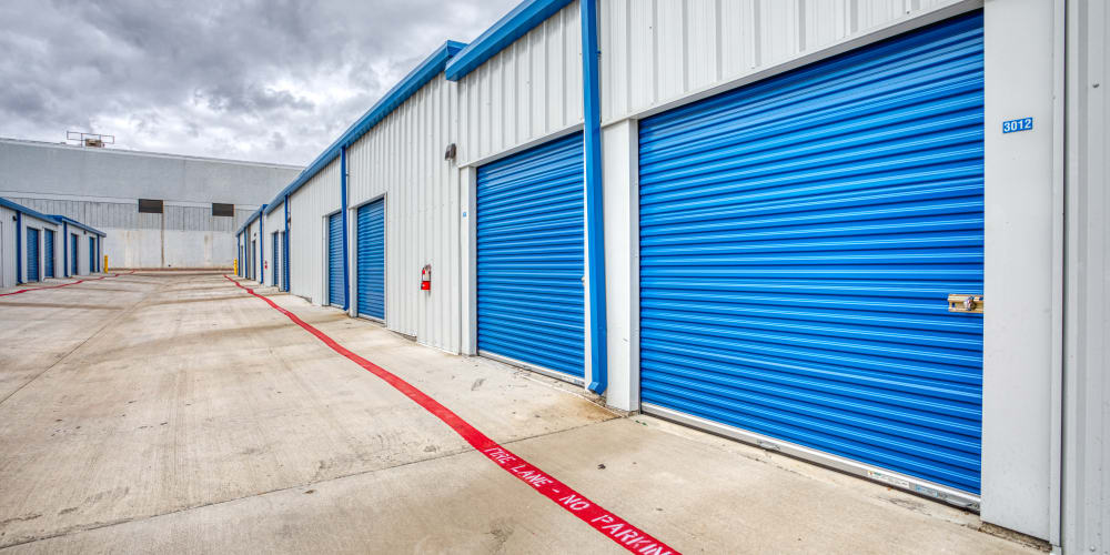 Large blue roll-up doors of our self storage units at Devon Self Storage in Fort Worth, Texas