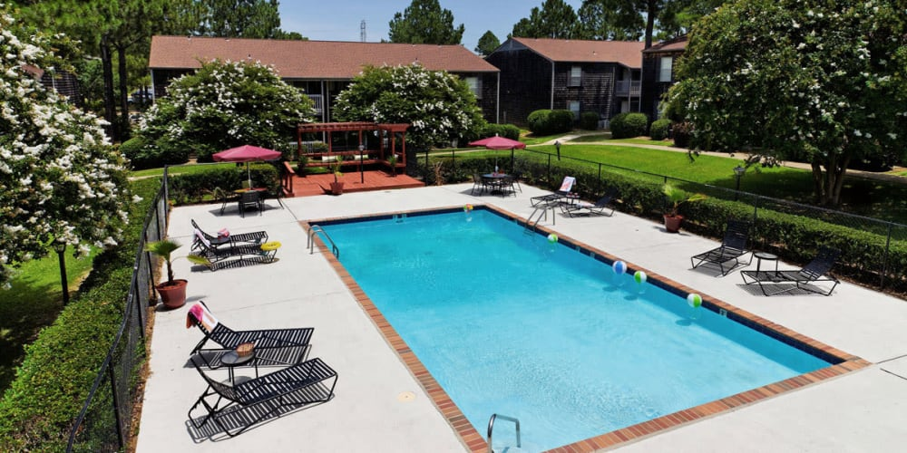 Beautifully manicured landscape around pool at Pinebrook Apartments in Ridgeland, Mississippi