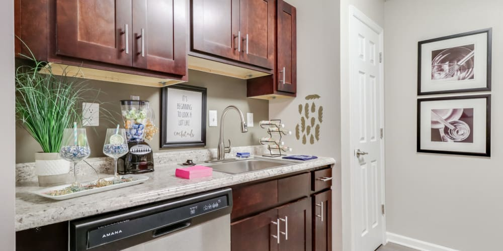Entryway leading into an apartment kitchen at Pinebrook Apartments in Ridgeland, Mississippi