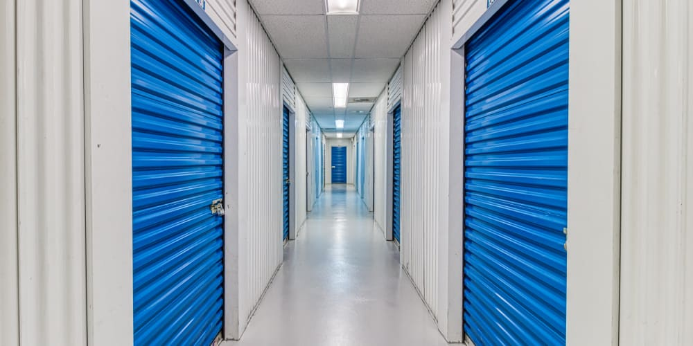 Walkway through climate-controlled storage in Thousand Palms, California at Devon Self Storage