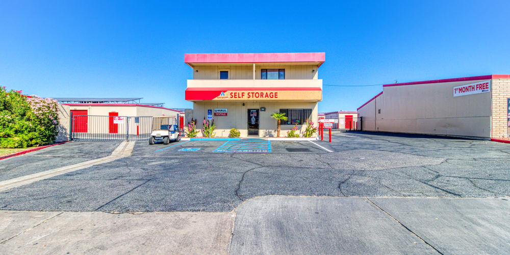 Parking lot and entry into Devon Self Storage in Cathedral City, California