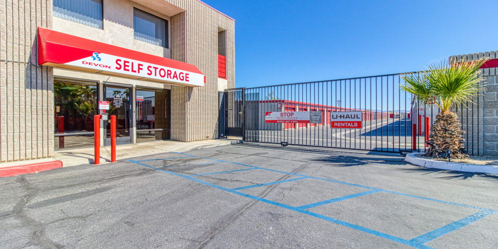 Front office and gated entry into Devon Self Storage in Palm Springs, California