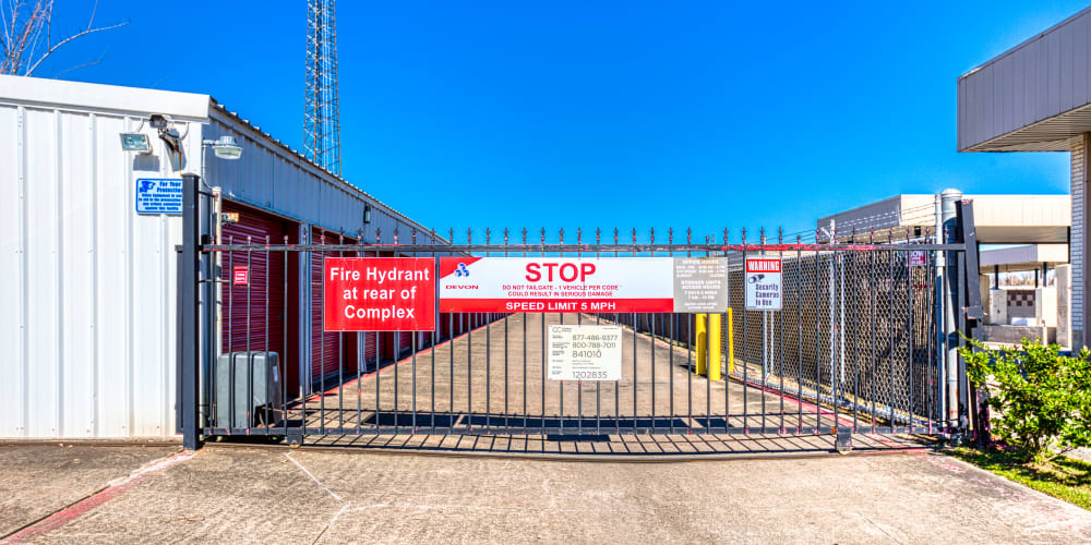 Gated entry leading into Devon Self Storage in Pasadena, Texas