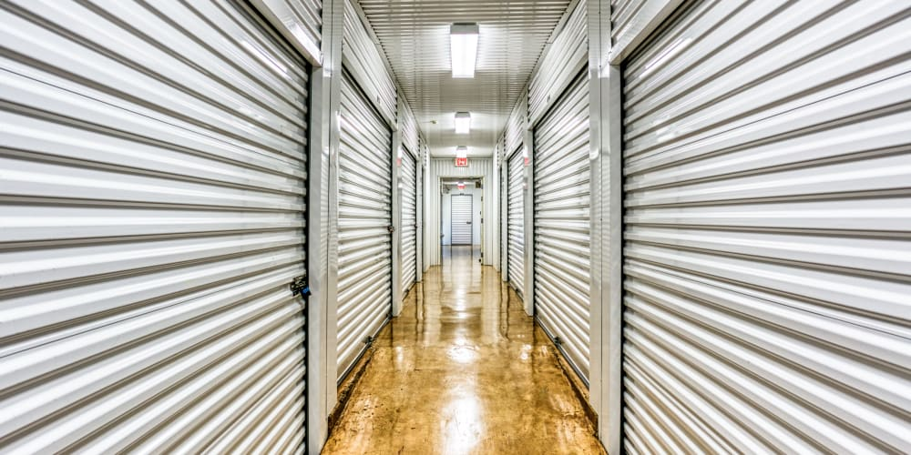 Walkway through climate-controlled storage units at Devon Self Storage in Greenville, Texas