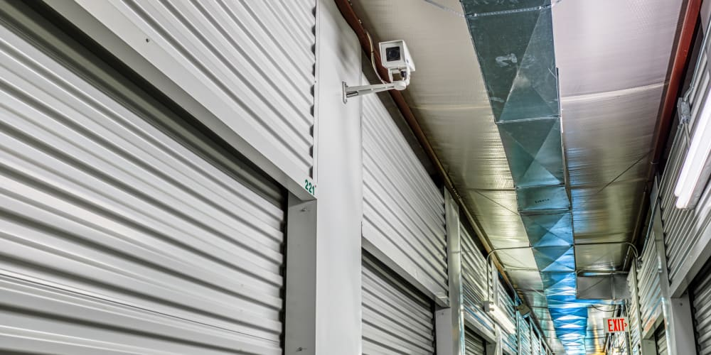 Video surveillance over climate-controlled storage units in Greenville, Texas at Devon Self Storage