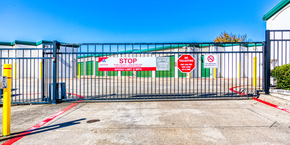Gated entry leading into Devon Self Storage in Sherman, Texas