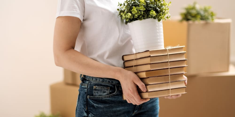 Packing books for storage at Devon Self Storage in Grand Rapids, Michigan