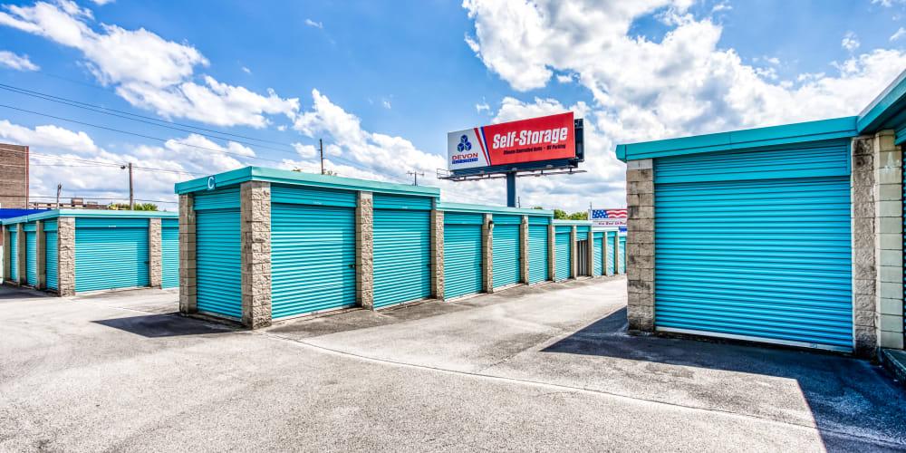 A row of outdoor storage units at Devon Self Storage in Madison, TN