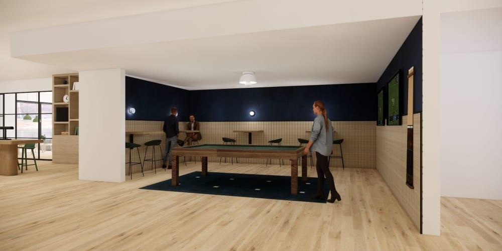Community game room with a pool table at Ellington Midtown in Atlanta, Georgia