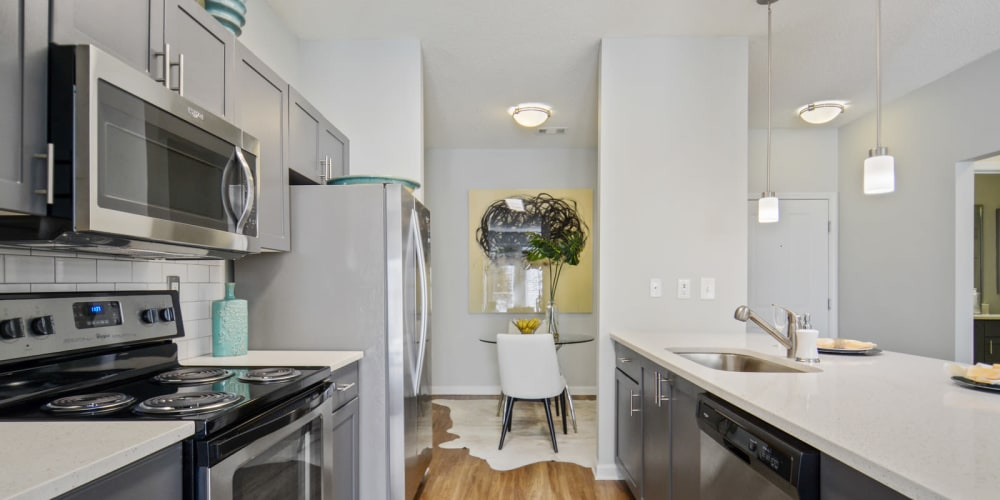 Fully equipped kitchen with stainless steel appliances at Ellington Midtownin Atlanta, Georgia