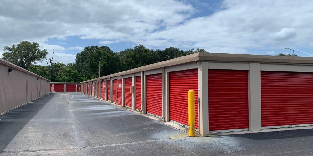 Ground-level outdoor storage units at StorQuest Self Storage in Odessa, Florida