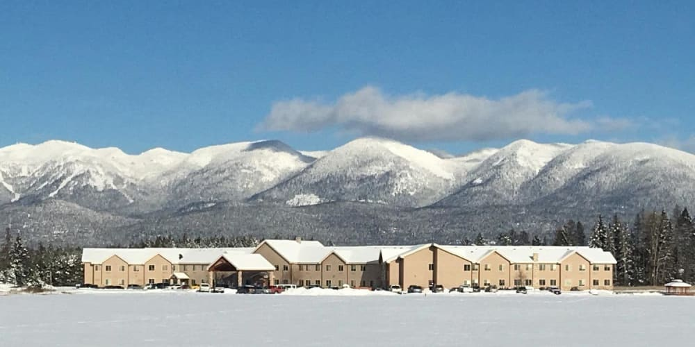 Breath taking mountain views in the background of upscale senior living facility at The Springs at Whitefish in Whitefish, Montana