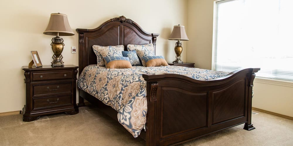 Upscale senior living bedroom with wood detailing at The Springs at Butte in Butte, Montana