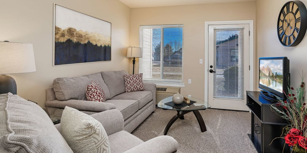 upscale living room in apartment at The Springs at Grand Park in Billings, Montana