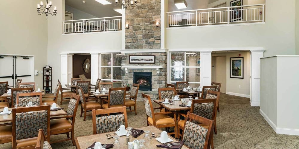Elegant formal dining room with chandeliers at The Springs at Grand Park in Billings, Montana