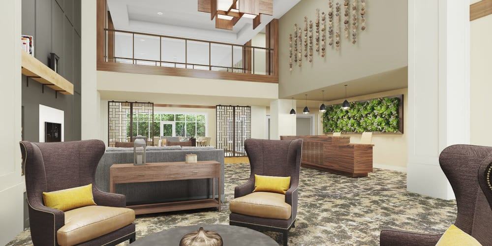 Brightly lit upscale senior living common room complete with wood accents, comfy armchairs, and modern vaulted ceilings at The Springs at Sherwood in Sherwood, Oregon