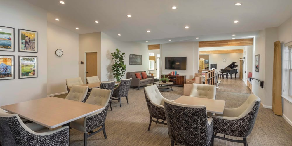 Relaxing lounge with comfy chairs and coffee tables perfect for card games at The Springs at Clackamas Woods in Milwaukie, Oregon