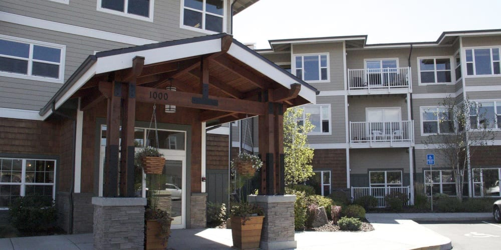 Inviting outside entrance of upscale senior living facility at The Springs at Mill Creek in The Dalles, Oregon