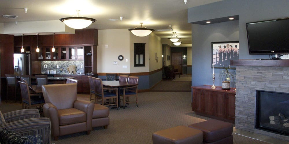 Classic communal lounge area with comfy leather armchairs, television and fireplace at The Springs at Mill Creek  in The Dalles, Oregon