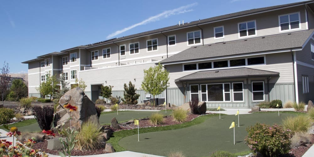 Grassy area complete with miniature golf putting area and stone landscaping at The Springs at Mill Creek in The Dalles, Oregon