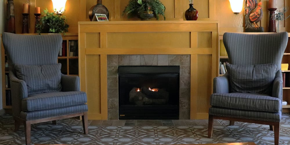 Comfy puzzle room complete with arm chairs and fireplace at The Springs at Sunnyview in Salem, Oregon
