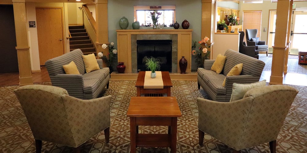 Comfy sitting area complete with flowers and fireplace in upscale senior living facility at The Springs at Sunnyview in Salem, Oregon