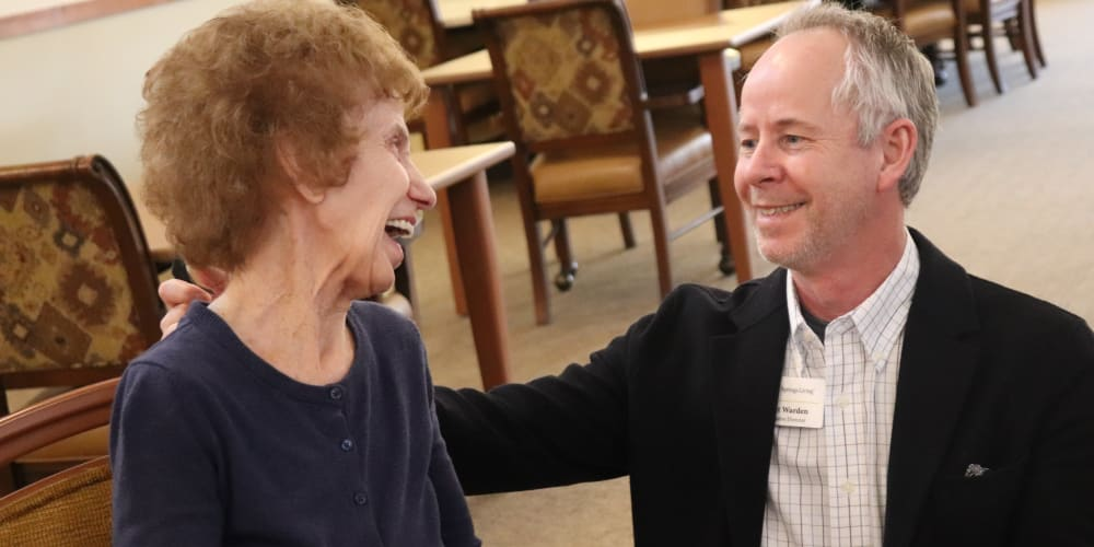Resident chatting with staff member at The Springs at Missoula in Missoula, Montana.