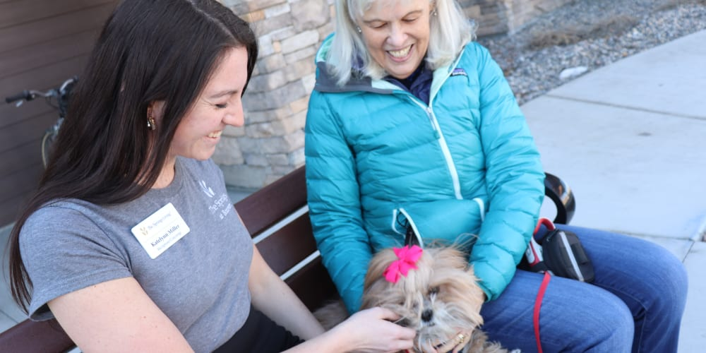 Residents with her dog and caregiver at The Springs at Bozeman in Bozeman, Montana