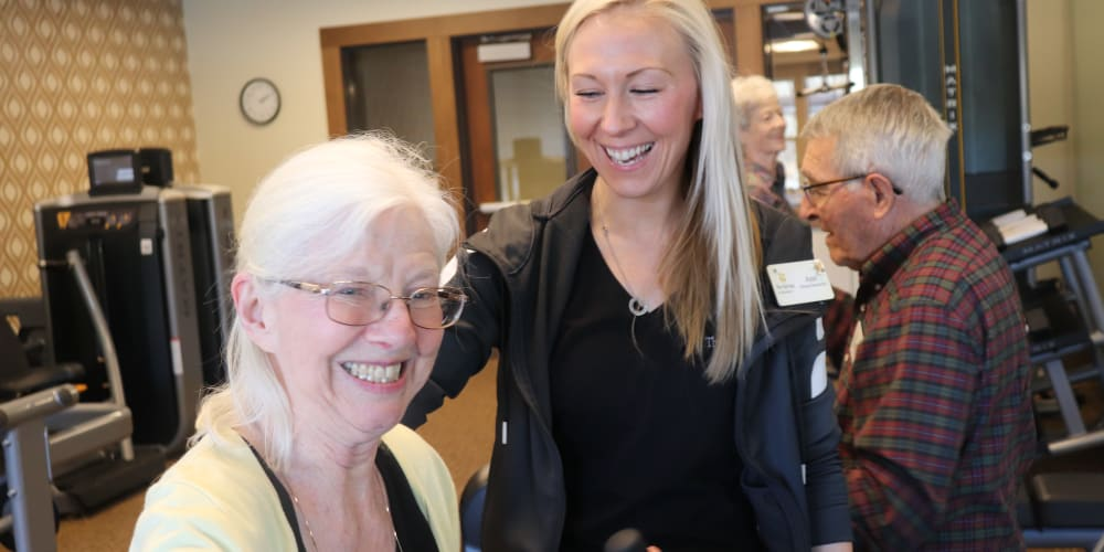 Resident smiling with care giver at The Springs at Bozeman in Bozeman, Montana