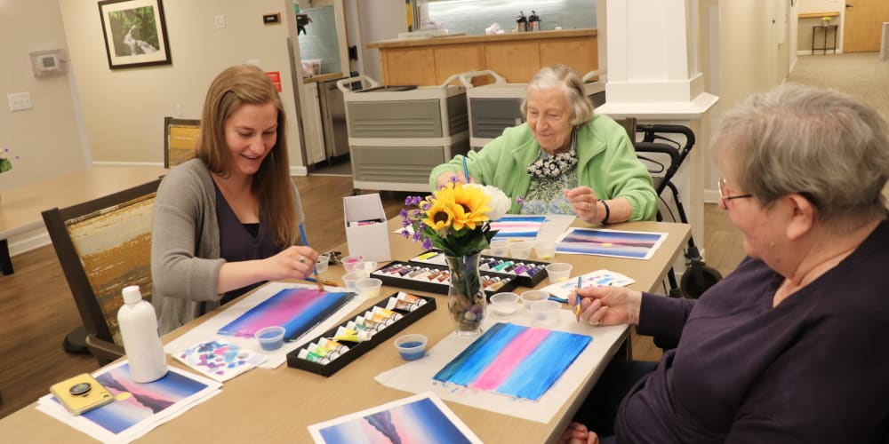 Residents enjoying an art class at The Springs at Clackamas Woods in Milwaukie, Oregon