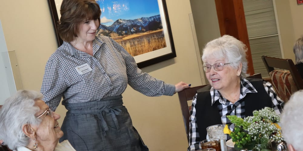Two residents dining in the lounge at The Springs at Butte in Butte, Montana