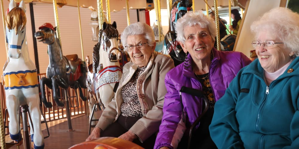 Residents socializing at a carousel at The Springs at Butte in Butte, Montana
