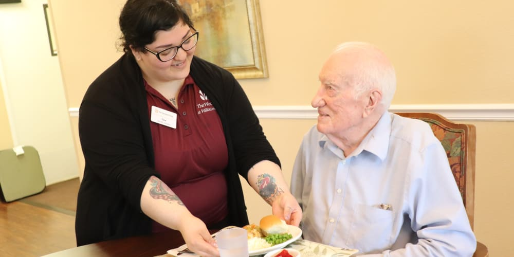 Resident  being served by caregiver at The Springs at Willowcreek in Salem, Oregon