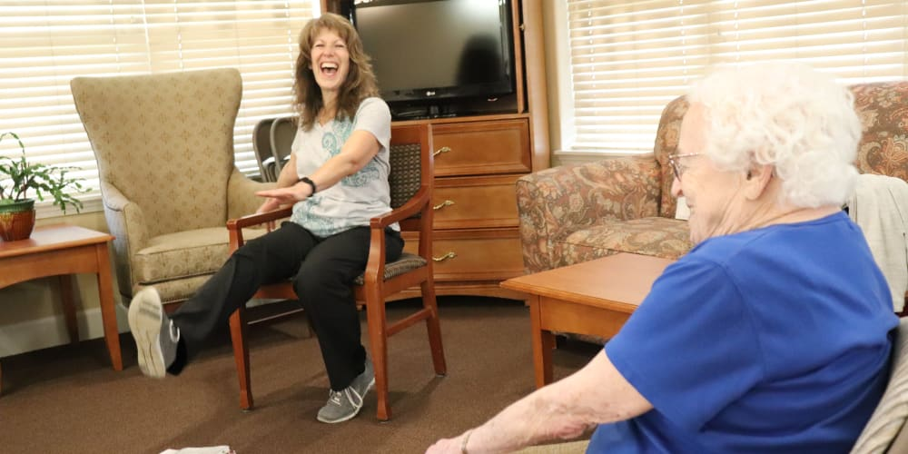 Resident exercising with caregiver at The Springs at Willowcreek in Salem, Oregon