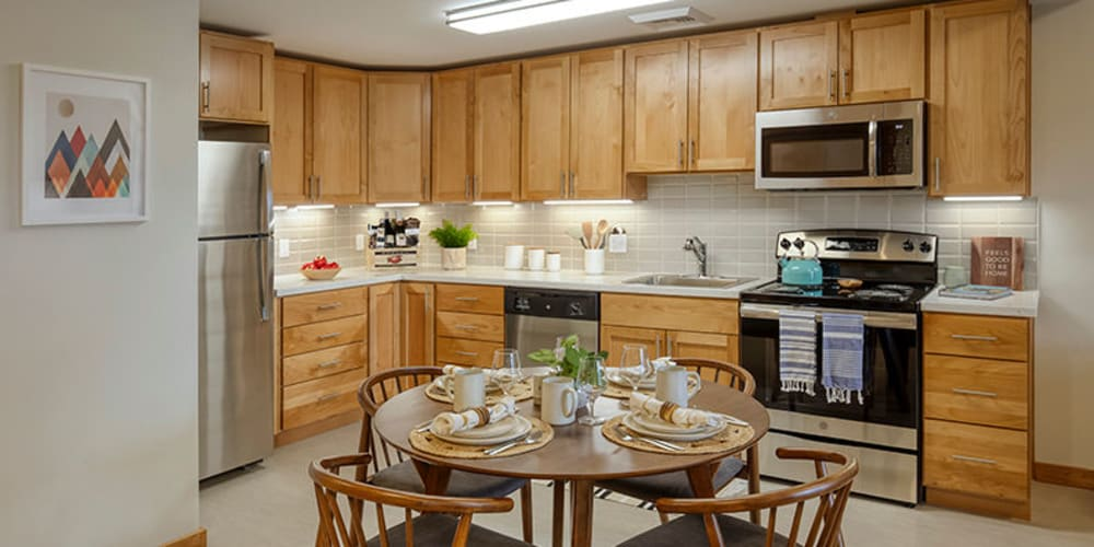 Well lit kitchen with wood accents at The Springs at Sherwood in Sherwood, Oregon