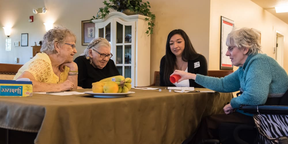 Residents and caregivers having a game night at The Springs at Willowcreek in Salem, Oregon
