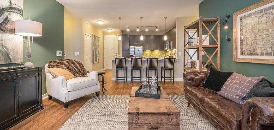 Wide-angle view of lavish living room in model apartment at The Abbey at Spring Town Center