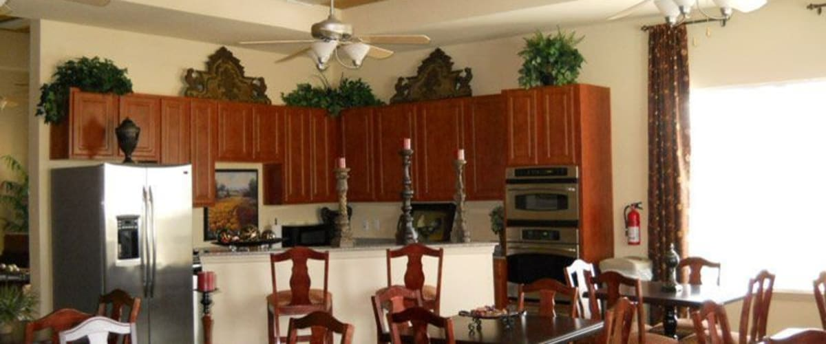 A community kitchen for entertaining guests at Woodside Manor in Conroe, Texas