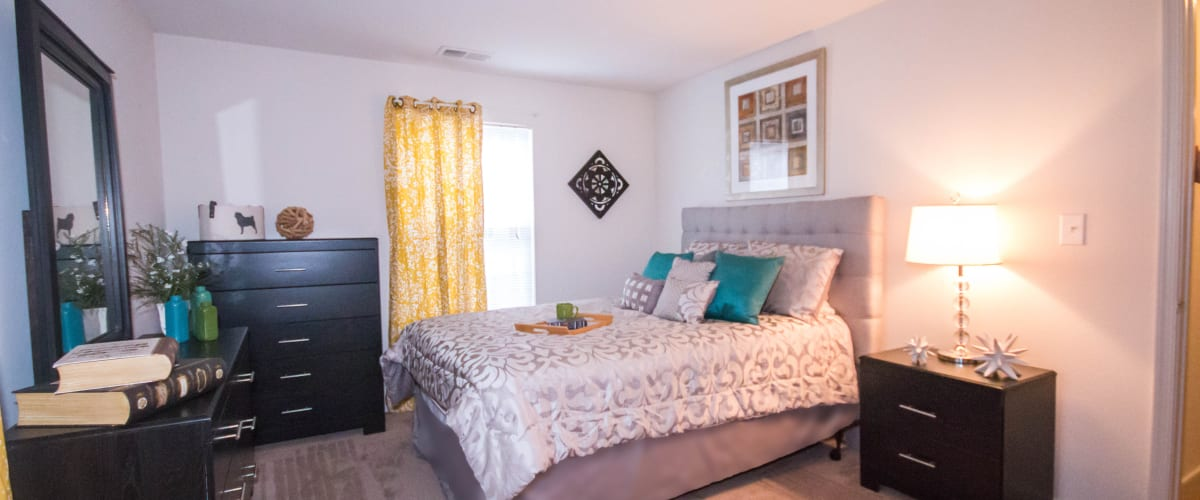 A large bedroom with plush carpeting at Creekpointe in Midlothian, Virginia